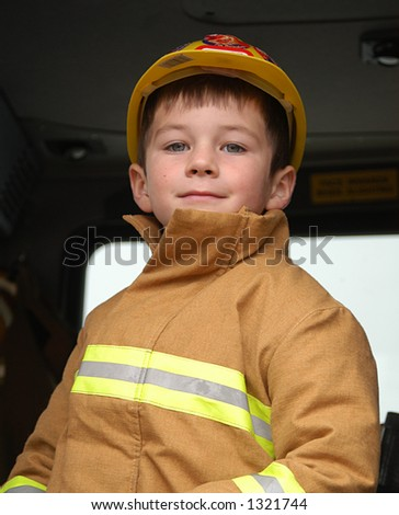 boy dressed as fire fighter - stock photo