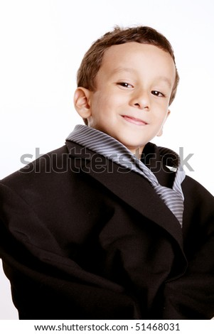 Boy dressed in suit tie over white background