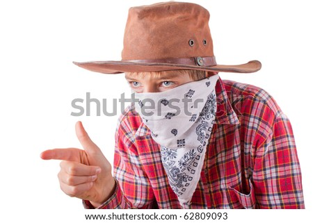 boy dressed up as a bandit for halloween holds his hand like a gun isolated on white - stock photo