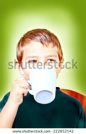 boy drink from a cup - stock photo