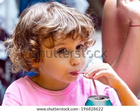 Boy drinking a cola - stock photo