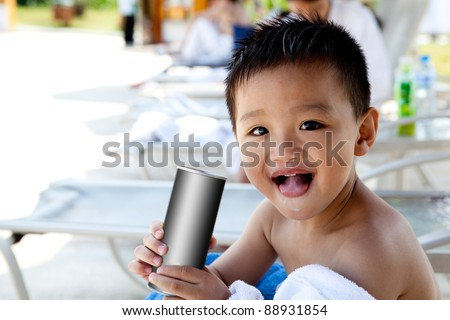 boy drinking and smile - stock photo