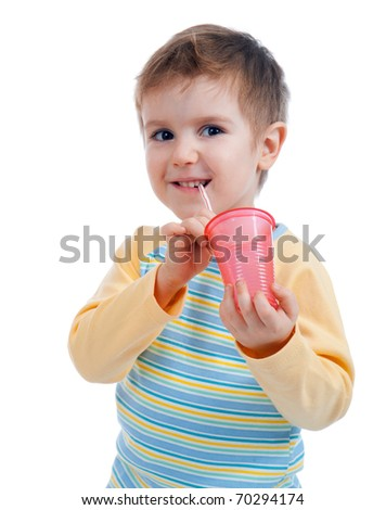 Boy drinking juice isolated on white