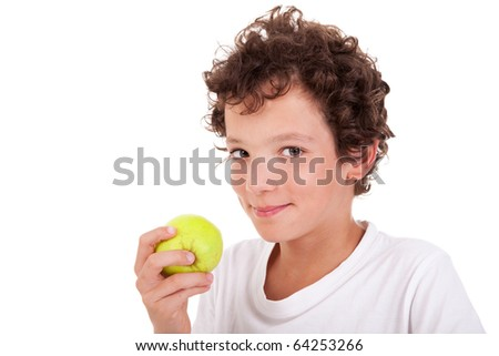 boy eating a green apple, isolated on white background