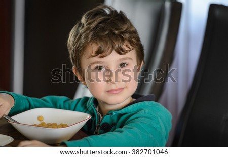 Boy eating cerial