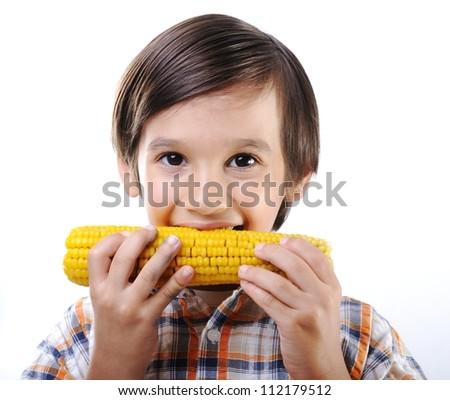 Boy eating corn - stock photo