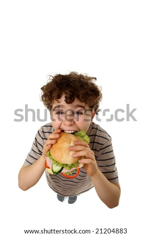 Boy eating healthy sandwich isolated on white background