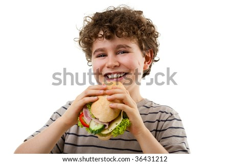 Boy eating healthy sandwiches isolated on white background