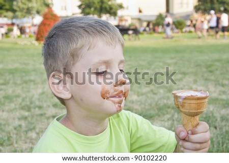 Boy eating ice cream. - stock photo