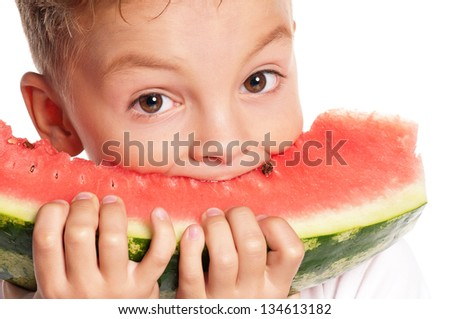 Boy eating slice of watermelon on white background - stock photo