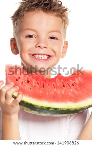 Boy eating slice of watermelon on white background