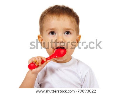 boy eats with a spoon