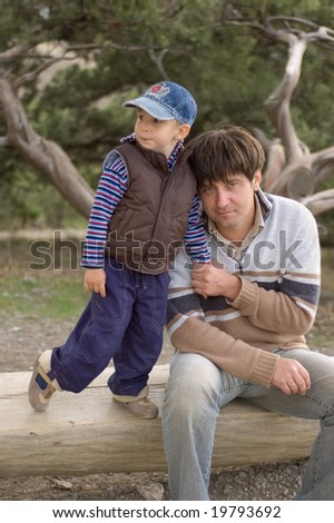 boy embrace his father outdoor - stock photo