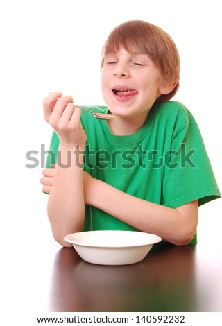 Boy Enjoys a Tasty Treat (green shirt for easy color replacement) - stock photo