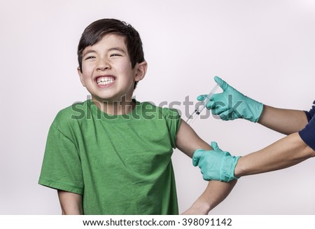 Boy feels the pain from syringe. - stock photo