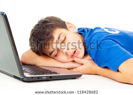 boy fell asleep at the notebook isolated - stock photo