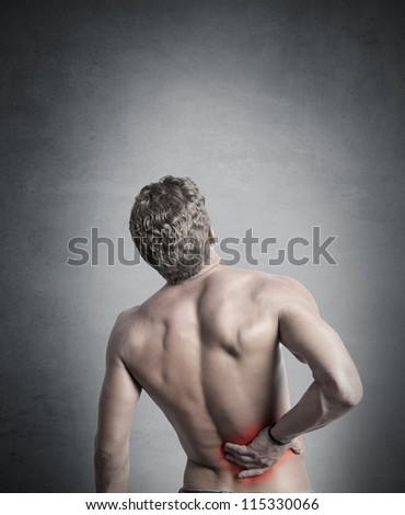 boy felt back pain - stock photo