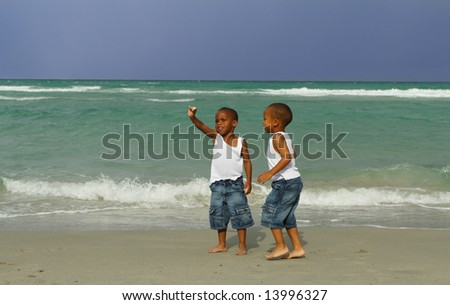 Boy Finding a Sea Shell - stock photo