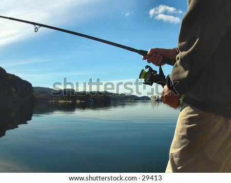 Boy fishing by the ocean - stock photo
