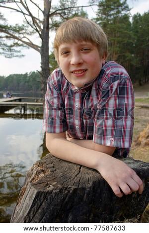 Boy fishing on the shores of beautiful Lake - stock photo