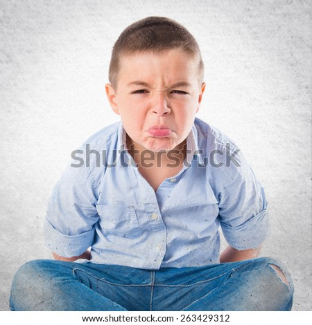 Boy furious over textured background