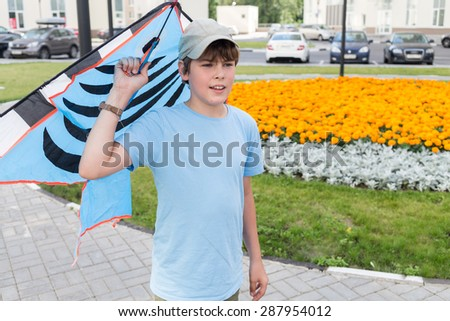 boy gets ready to launch a kite - stock photo