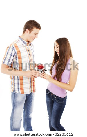 Boy giving present to girl.  All on white background. - stock photo