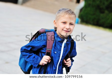 boy glad to go from school to home - stock photo