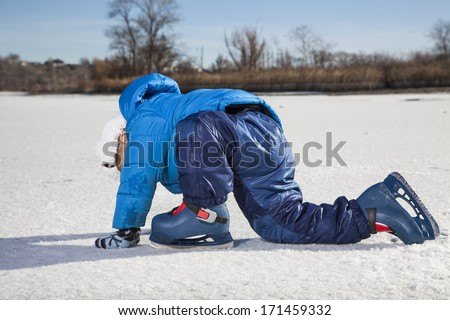 boy having fun on ice skate - stock photo