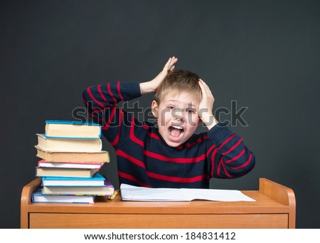 Boy Having Problems With His Homework. Panic - stock photo