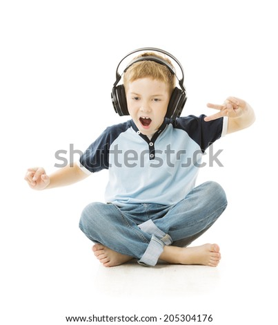 Boy headphones listening to music and singing. Child portrait over white background  - stock photo