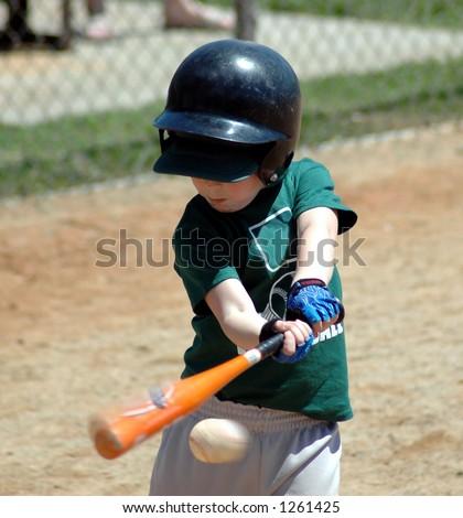 boy hitting a baseball - stock photo