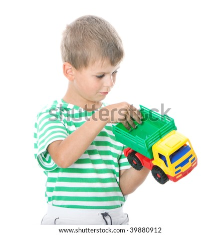 Boy holding a car - stock photo