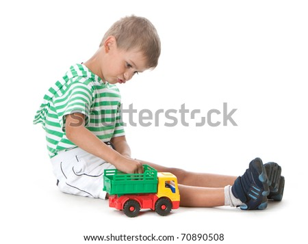 Boy holding a car  isolated on white background