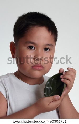 Boy holding a leaf - concept for natural environment preservation
