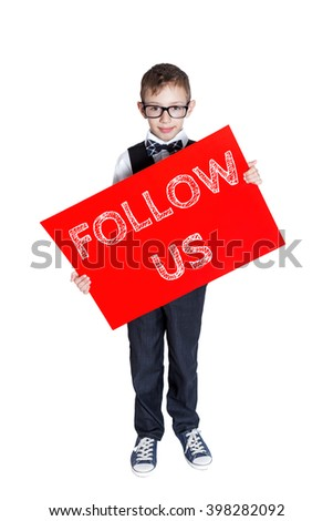 Boy holding a red banner with text Follow us isolated on white background
