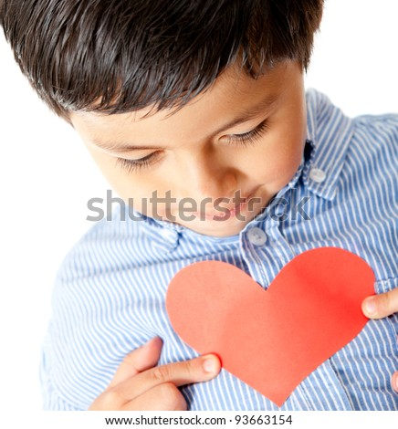 Boy holding a red heart for Valentines Day - isolated - stock photo