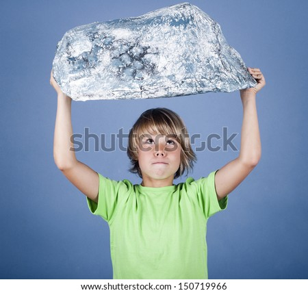 Boy holding a stone  - stock photo