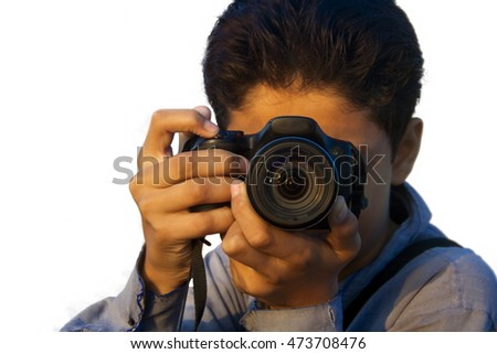 Boy holding Camera, isolated on white. Concept of Photo Journalism.