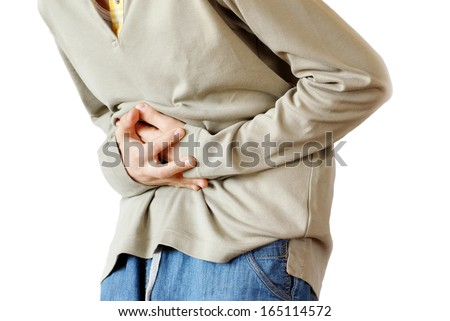 boy holding hands on his stomach  - stock photo