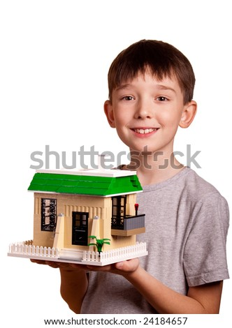 Boy holding house isolated on white - stock photo