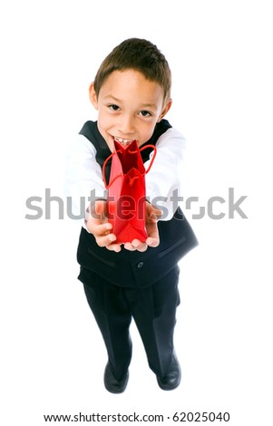 boy holding red bag with a gift in his hands isolated on white - stock photo