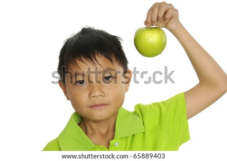 boy holds an apple. Isolated on white background - stock photo