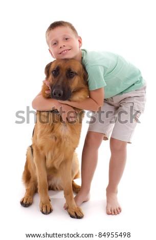 boy hugging his dog - stock photo