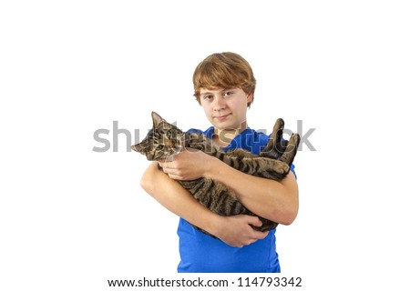 boy hugging with his cat - stock photo