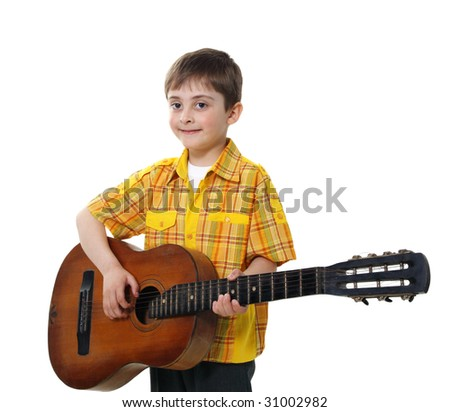 Boy in a black suit and with an old guitar on a white background