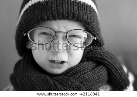 boy in a cap and glasses - stock photo