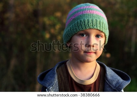 boy in a cap on the nature, autumn - stock photo