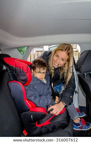 boy in a child seat, a symbol of protection, care, vehicle safety - stock photo