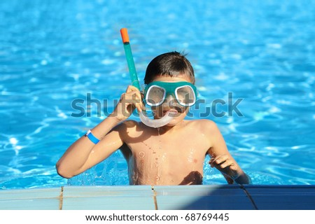 Boy in a swimming pool - stock photo